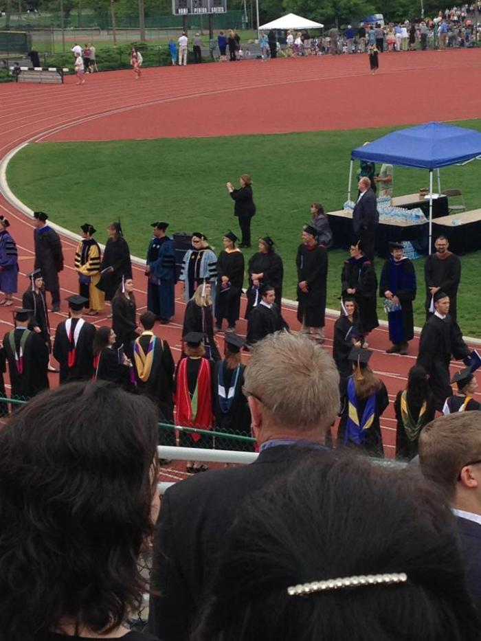 History graduates march into Shoemaker Field