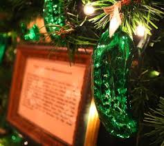 A Christmas pickle ornament in a Christmas tree.